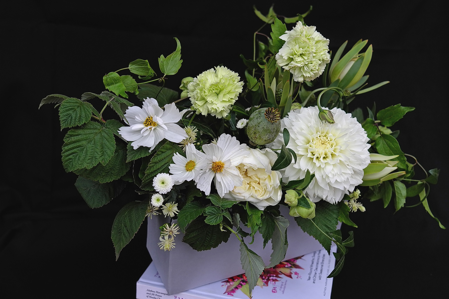 Flower arrangement, flower box of the most beautiful garden flowers: gleoborus, chrysanthemum, kosmeja, furry garden rose and wild clematis.